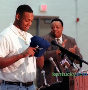 Dennis Johnson, shown announcing his commitment to UK as his father, Alvis, looks on. (Herald-Leader photo by Frank Anderson)