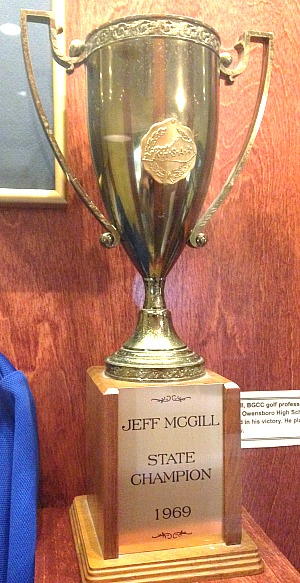 Jeff McGill's 1969 state title cup is in the trophy case at Bowling Green Country Club, along with other memorabilia, including donations from state champs Emma Talley and Justin Thomas.